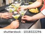 hands of friends having fun at... | Shutterstock . vector #1018322296