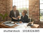 business people discussing... | Shutterstock . vector #1018326385