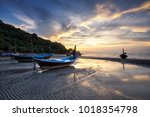 fishing boat and sunset at the... | Shutterstock . vector #1018354798