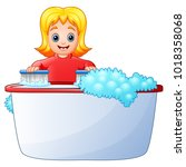 happy girl cleaning bathtub on... | Shutterstock .eps vector #1018358068