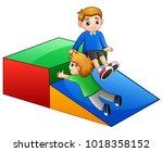 children playing slide in... | Shutterstock .eps vector #1018358152