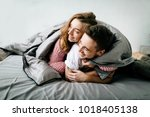 cheerful couple under the... | Shutterstock . vector #1018405138