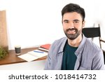 young bearded man in casual... | Shutterstock . vector #1018414732