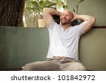 man relaxing with hands on his... | Shutterstock . vector #101842972