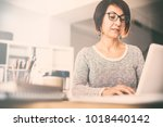 middle age woman using computer | Shutterstock . vector #1018440142