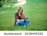 young woman using tablet... | Shutterstock . vector #1018445332