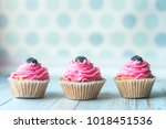 beautiful cupcake with berry | Shutterstock . vector #1018451536