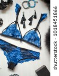 blue lace lingerie on the white ... | Shutterstock . vector #1018451866