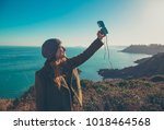 girl take photo with vintage... | Shutterstock . vector #1018464568