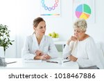 dietician with measure tape... | Shutterstock . vector #1018467886