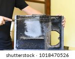 man cleaning wood burning stove.... | Shutterstock . vector #1018470526