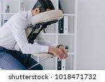 businessman sitting in massage... | Shutterstock . vector #1018471732