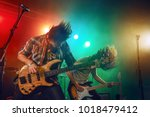rock band performs on stage.... | Shutterstock . vector #1018479412