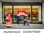 motion blurred shoppers walking ... | Shutterstock . vector #1018479685