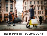 motion blurred shoppers... | Shutterstock . vector #1018480075