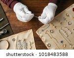 jeweler working in workshop ...   Shutterstock . vector #1018483588