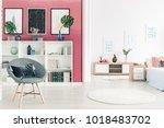 leaves on white cabinet against ... | Shutterstock . vector #1018483702
