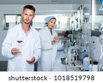 attentive adult man testing... | Shutterstock . vector #1018519798