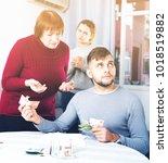 elderly mother asking adult son ... | Shutterstock . vector #1018519882