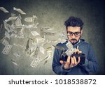 sad man looking at his wallet... | Shutterstock . vector #1018538872