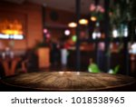 empty wooden table and blurred... | Shutterstock . vector #1018538965