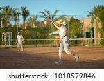 senior couple playing tennis | Shutterstock . vector #1018579846