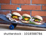 burgers on the sckateboard on... | Shutterstock . vector #1018588786