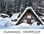 a farmhouse at shirakawago ... | Shutterstock . vector #1018591225