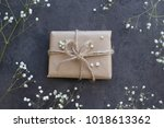 gift in craft paper and the...   Shutterstock . vector #1018613362