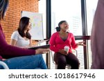 group of casual multiethnic... | Shutterstock . vector #1018617946