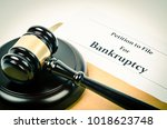 Small photo of Bankruptcy document with wooden gavel, Buseniss concept.