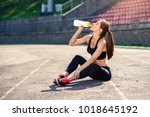Fitness Runner Woman Drinking...