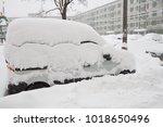 the car after a snowfall | Shutterstock . vector #1018650496