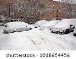 cars after snowfall | Shutterstock . vector #1018654456