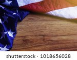 usa flag on brown wooden board. ... | Shutterstock . vector #1018656028