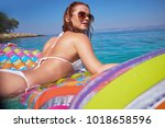 happy woman in bikini lying on... | Shutterstock . vector #1018658596