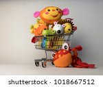 shopping trolley cart with toys ... | Shutterstock . vector #1018667512