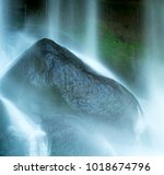 waterfall on rocks at the... | Shutterstock . vector #1018674796