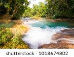 rainforest waterfalls of agua... | Shutterstock . vector #1018674802