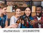 happy young multiethnic friends ... | Shutterstock . vector #1018680598