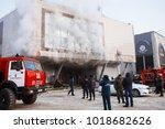 burning shopping mall. smoke... | Shutterstock . vector #1018682626