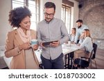business coworkers discussing... | Shutterstock . vector #1018703002