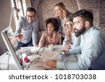 group of business partners... | Shutterstock . vector #1018703038