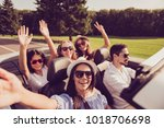 ladies and guy driver  chics... | Shutterstock . vector #1018706698