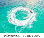 people are playing a jet ski in ... | Shutterstock . vector #1018716592
