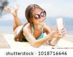 sexy girl with sunglasses... | Shutterstock . vector #1018716646