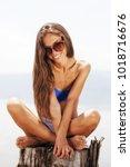 happy beautiful girl sitting on ... | Shutterstock . vector #1018716676
