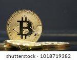 golden bitcoins on the money | Shutterstock . vector #1018719382