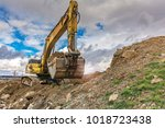 Excavator Loaded With Earth And ...
