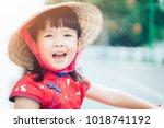 happy little girl wearing...   Shutterstock . vector #1018741192